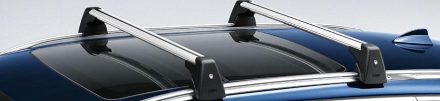 Střešní nosiče na atomobily pro přepravu kol, lyží a dalších produktů.